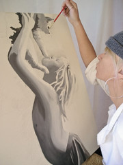 woman painting on a canvas