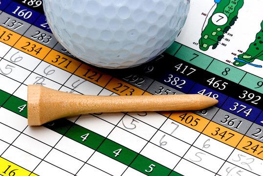 golf tee, scorecard, and ball