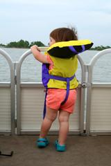 girl wearing life jacket