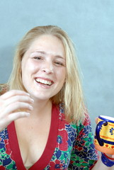 girl laughing with cup