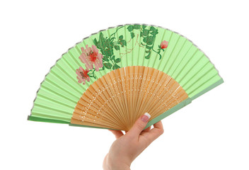 female hand with decorated fan
