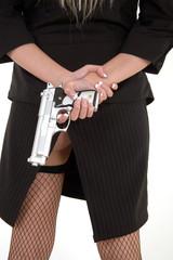 a gun behind her back