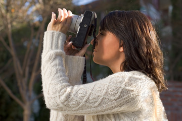 girl with slr photo camera