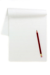 white lined paper and pencil