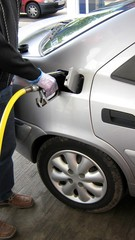 refulling a car with diesel or petrol. wheels