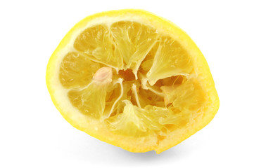 squeezed out lemon on white background