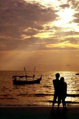 loving couple on beach at sunset