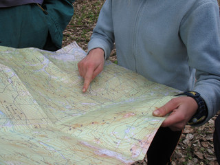 person examine a map