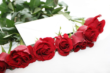 red roses bouquet with letter