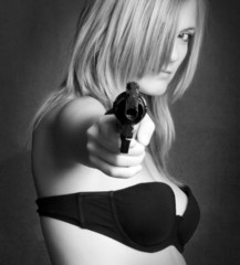 girl pointing gun