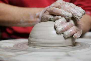 potter working clay