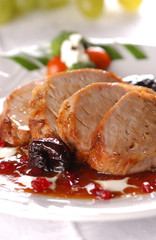 grilled pork meat with dry plum and redcurrant jam