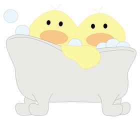 two duclings in a bathtub