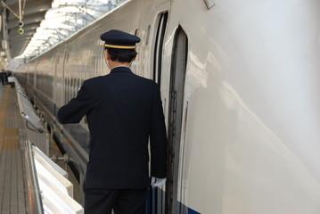 guard on train platform