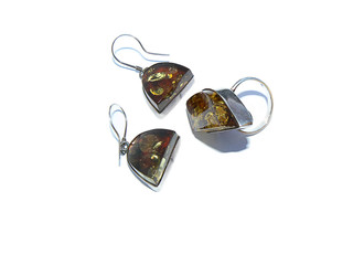 silver ring and earrings with amber