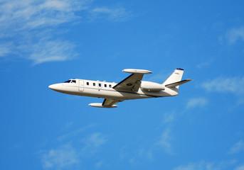 luxury private jet in flight