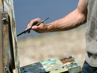artist's hand with a brush