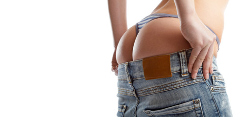 sexy woman trying on a pair of blue jeans
