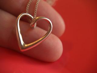 heart on fingers