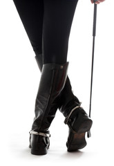 beautiful legs in black leather horseman boots wit