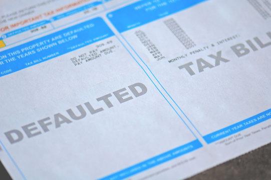 defaulted tax bill