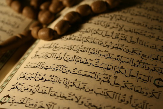 pages of holy koran & rosary