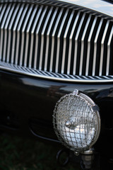 detail of classic british car foglight and grille