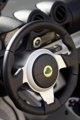steering wheel and dash of british sports car