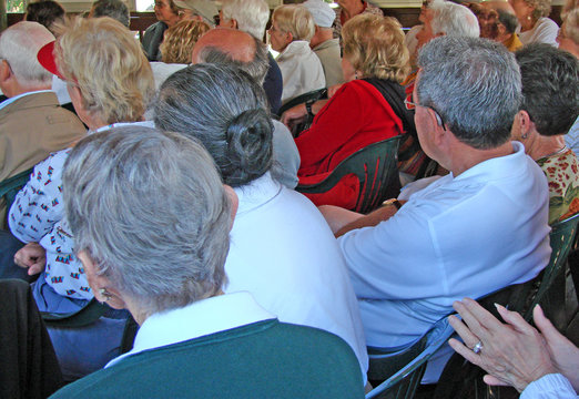 senior audience attending an outdoor event