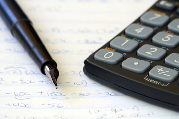 fountain pen with calculator and mathematics