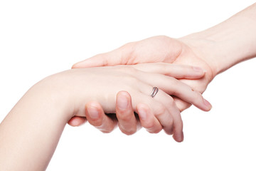 the man gently holds a female hand