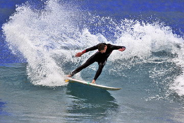 a surfer executing a cutback maneuver