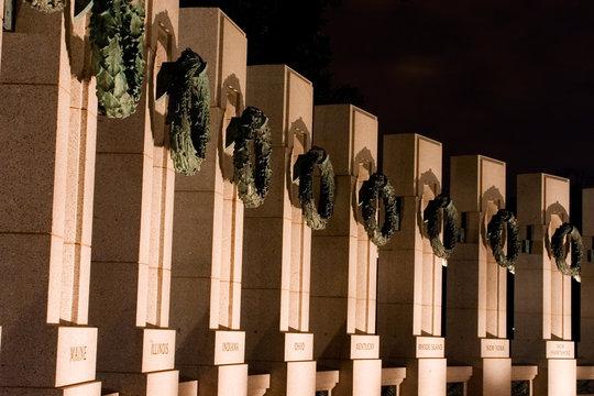 world war ii memorial pillars by night