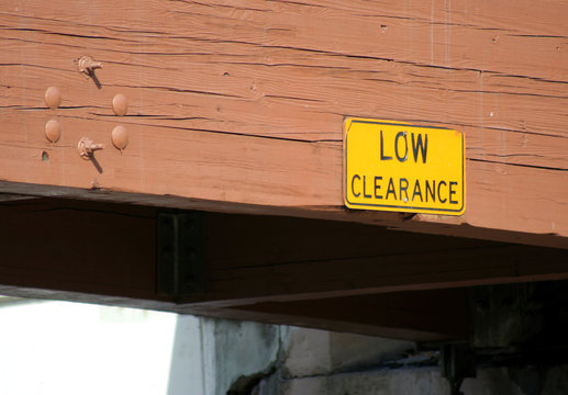 low clearance sign and bridge
