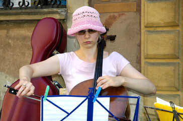 a young girl playing the music