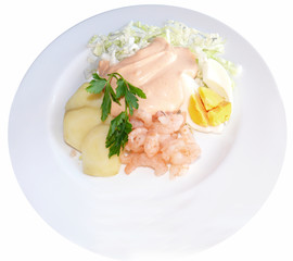 a shrimp salad dish with potatoes and an egg