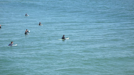 surfers waiting for action