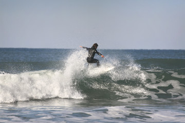 surfer on top of the wave