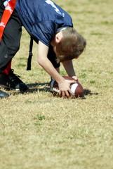 boy hiking football