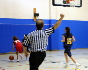 referee making a call at a girls basketball game