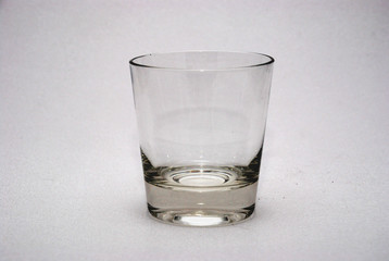 empty whiskey glass on white background