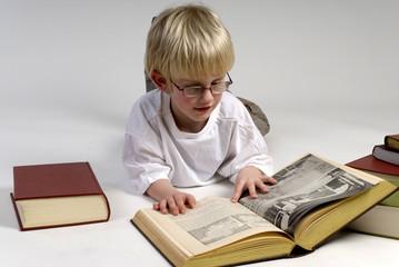 boy is reading books