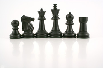 black chess pieces with reflections