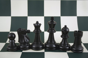 black chess pieces on a board