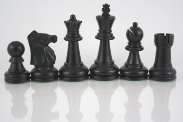 black chess pieces with reflection