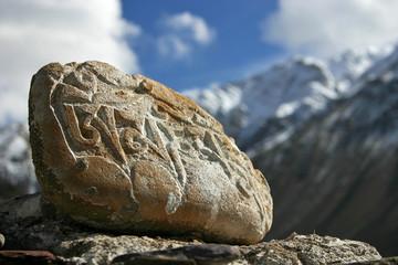 buddhist mani stones - sacred stones with religiou