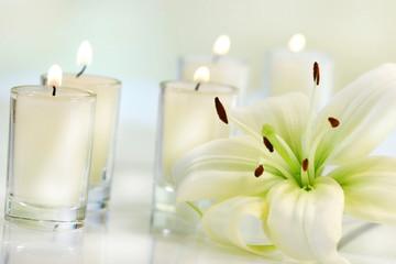lily flower with candle - fototapety na wymiar