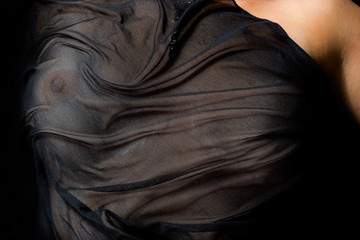 anonymous woman with breasts covered by black cloth.