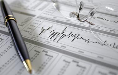 finances, graphiques, statistiques, lunettes