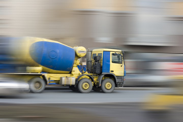 concrete mixer car rushing fast